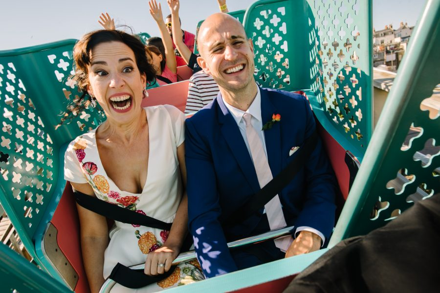 bride and groom on a rollercoaster